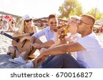 group of friends with guitar... | Shutterstock . vector #670016827