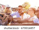 group of friends with guitar... | Shutterstock . vector #670016857