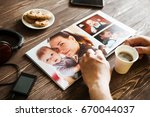 the hand man holding a family... | Shutterstock . vector #670044037