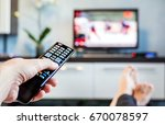 men with the remote control... | Shutterstock . vector #670078597