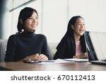 asian women working at... | Shutterstock . vector #670112413
