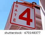 gate number 4 sign | Shutterstock . vector #670148377