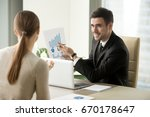 happy project manager holds... | Shutterstock . vector #670178647
