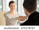 smiling beautiful woman shaking ... | Shutterstock . vector #670178767