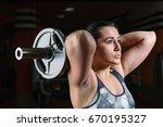 beautiful muscular bodybuilder... | Shutterstock . vector #670195327