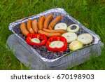 disposable grill with sausages  ...