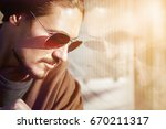a nice guy in sunglasses in the ... | Shutterstock . vector #670211317
