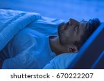 the man sleeping in the bed.... | Shutterstock . vector #670222207