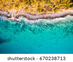 an aerial view of the beach at... | Shutterstock . vector #670238713
