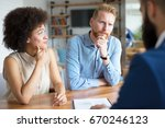 Small photo of Couple getting advice about buying a house.