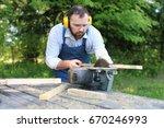 beard man working on circular... | Shutterstock . vector #670246993