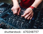 hands dj mixing music at the... | Shutterstock . vector #670248757