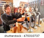 young mans selling fresh beer... | Shutterstock . vector #670310737