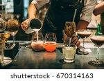 bartender making alcoholic...   Shutterstock . vector #670314163