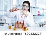 female researcher doing... | Shutterstock . vector #670322227