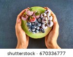 hands holding fresh melon with... | Shutterstock . vector #670336777