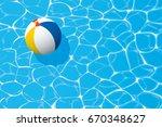 beach ball floating in a blue... | Shutterstock .eps vector #670348627