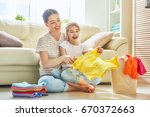 beautiful young woman and child ... | Shutterstock . vector #670372663
