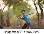 rural indian child playing...   Shutterstock . vector #670376593