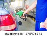 petrol gun with car | Shutterstock . vector #670476373