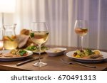 the food on the table and wine | Shutterstock . vector #670491313