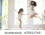 happy family at home. sisters... | Shutterstock . vector #670511743