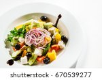 greek salad | Shutterstock . vector #670539277