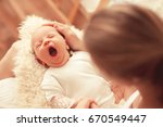 cute yawning infant baby on... | Shutterstock . vector #670549447
