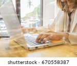 business woman hand using... | Shutterstock . vector #670558387