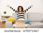 beautiful happy woman with arms ... | Shutterstock . vector #670571467