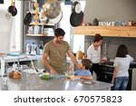 family in kitchen making... | Shutterstock . vector #670575823