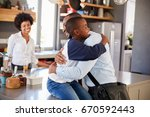 father saying goodbye to son as ... | Shutterstock . vector #670592443