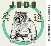 judoka tiger dressed in kimono | Shutterstock .eps vector #670605853