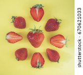 strawberries on a yellow... | Shutterstock . vector #670621033