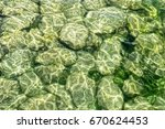 Covered Stones Under Water Of...