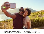young couple pose for holiday... | Shutterstock . vector #670636513