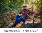 the young logger sits on a... | Shutterstock . vector #670647967