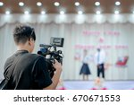 covering an event on stage with ... | Shutterstock . vector #670671553