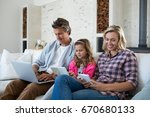 family using laptop  digital... | Shutterstock . vector #670680133