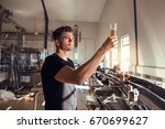 young man examining the quality ... | Shutterstock . vector #670699627