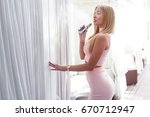 sexy woman smoke electronic... | Shutterstock . vector #670712947