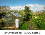 green house at a plot of an...   Shutterstock . vector #670755853