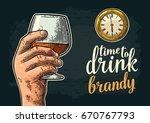 male hand holding glass brandy... | Shutterstock .eps vector #670767793