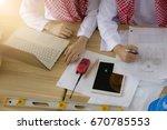 a business saudi man working on ... | Shutterstock . vector #670785553