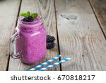 blackberry jogurt smoothie in... | Shutterstock . vector #670818217