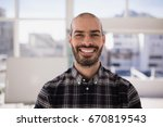 portrait of smiling executive... | Shutterstock . vector #670819543