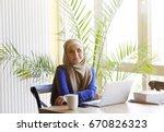 muslim asian woman working in... | Shutterstock . vector #670826323