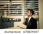asian business man stress with... | Shutterstock . vector #670829347