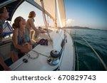 three young women adjust the... | Shutterstock . vector #670829743