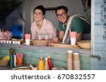 portrait of smiling waiter and... | Shutterstock . vector #670832557